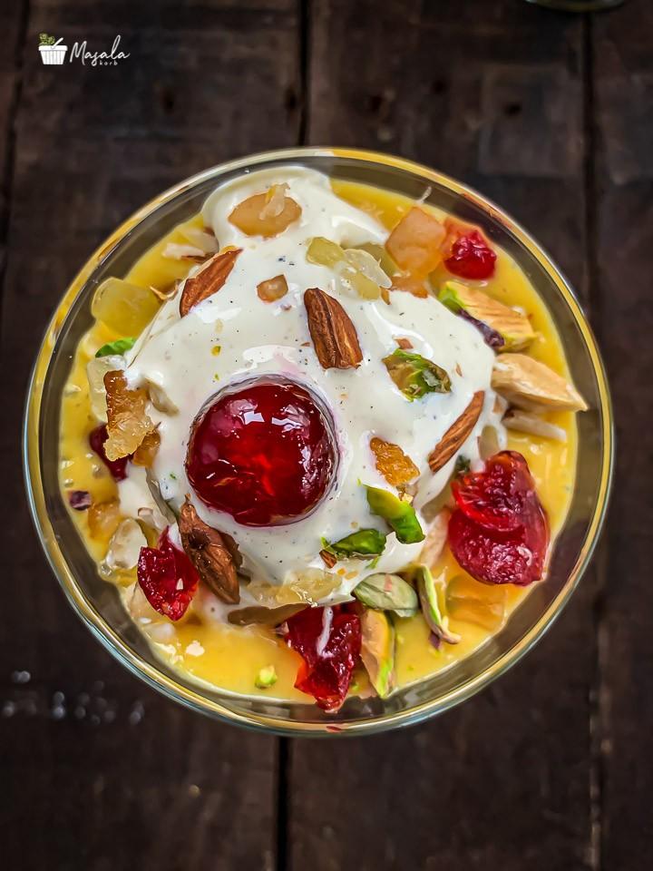 Top angle view of Mango milkshake topped with ice cream