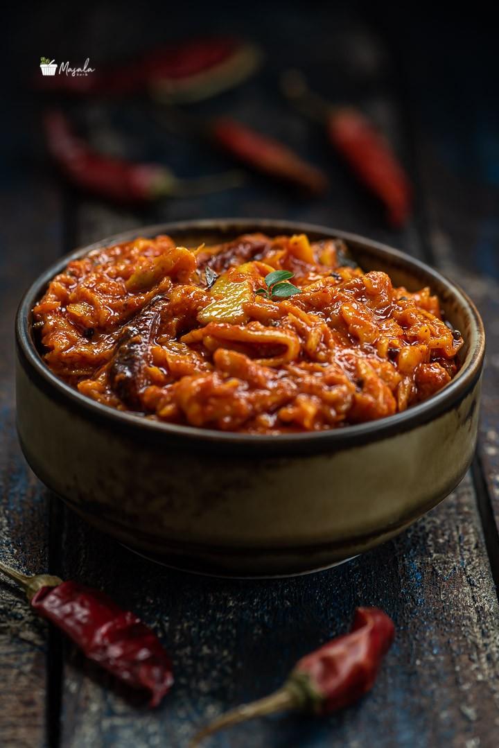 Mamidikaya turumu Pachadi served in a bowl.