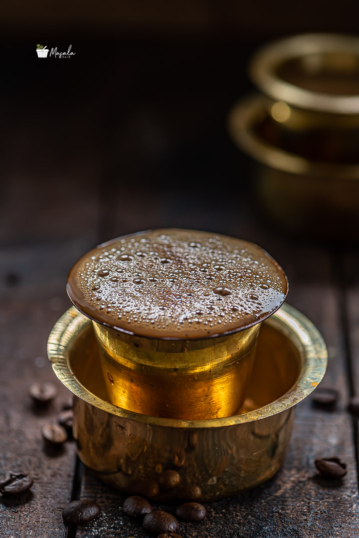 Degree coffee served in a brass dabarah and tumbler