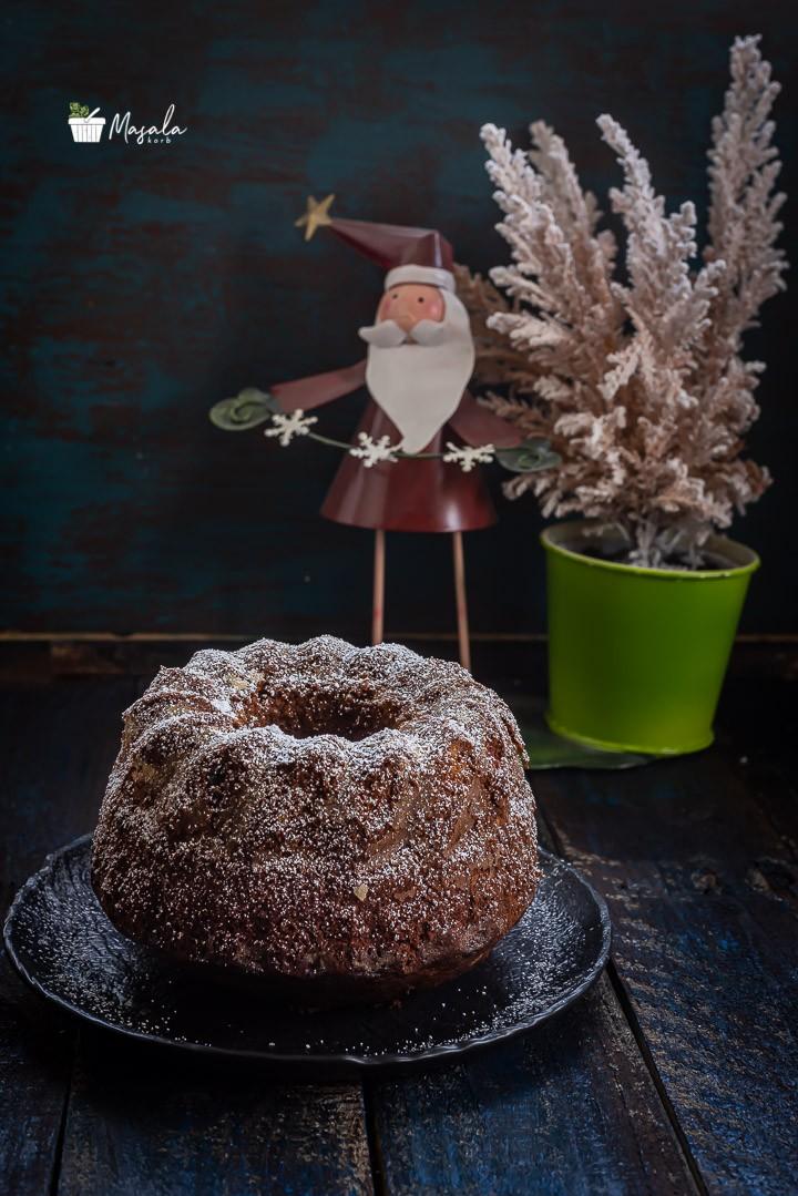 Kerala Plum Cake Recipe with Santa in the background.