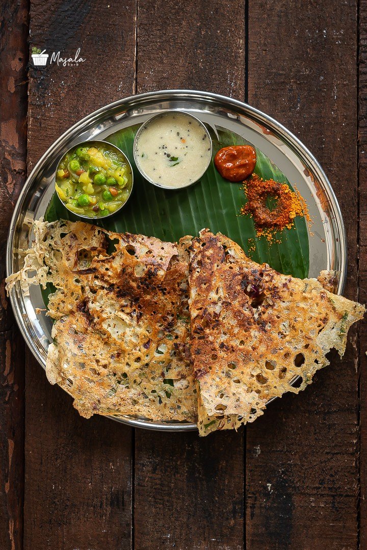 Instant Rava Dosa served with an array of condiments