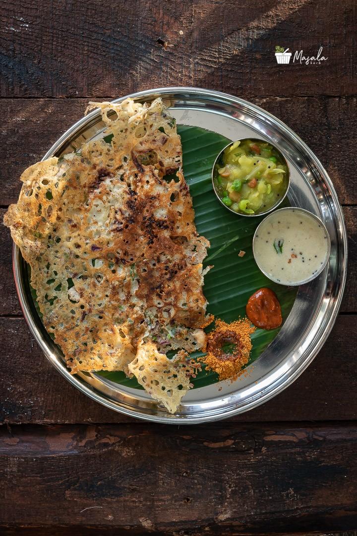 Suji Dosa with masala on the side & accompanied with coconut chutney