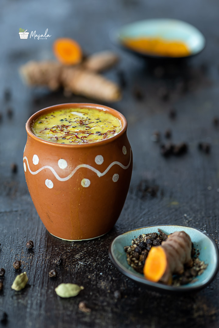 Golden Turmeric Milk Recipe aka Haldi Doodh with ingredients in the background