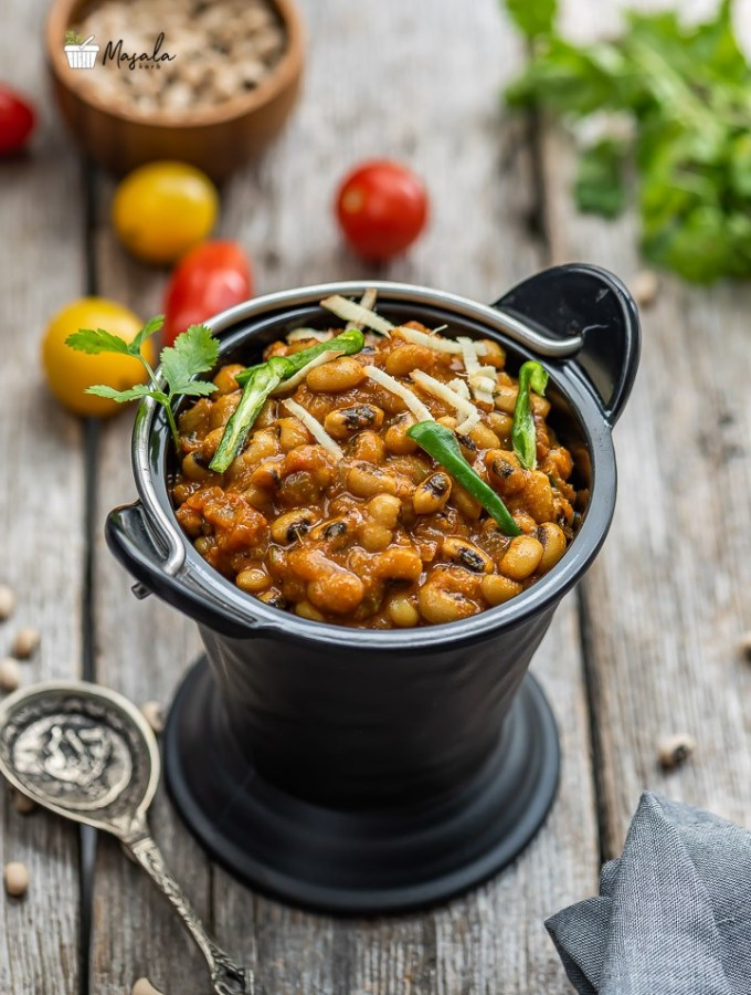 Black eyed peas curry served in a black bucket