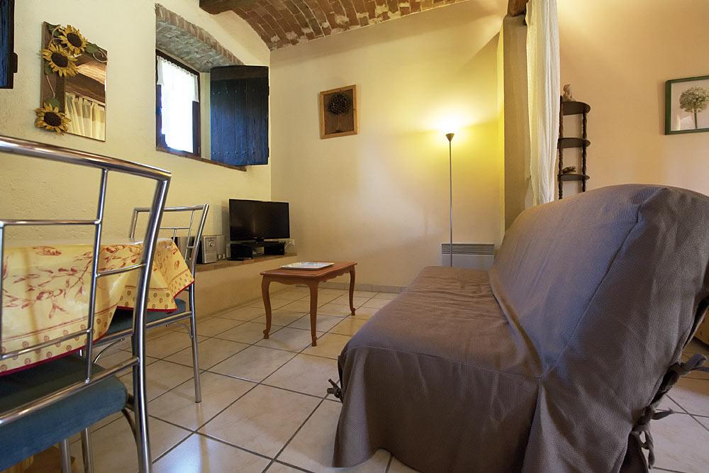 Le clic clac dans le coin salon au Romarin au Mas de la Baillyde, gîtes de charme en Cévennes