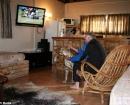 En la sala de estar con su dueño