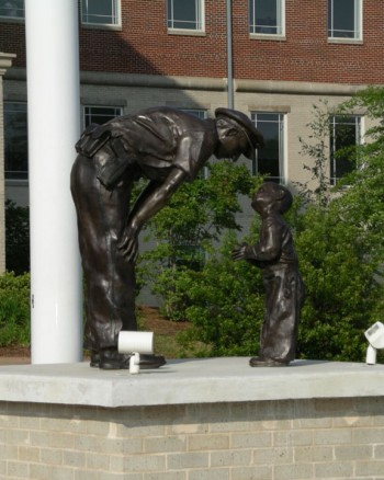 UNDATED HANDOUT IMAGE: A statue in Jonesboro, Ga. depicts Bill Beall's Pulitzer-winning photograph of a D.C. police officer and a boy taken in 1957. (Courtesy of Denny Beall)