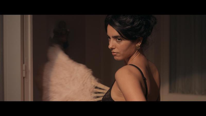 Hafsia Herzi in una scena del film Madame Claude. Photo: courtesy of Netflix.