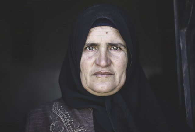 In 2003, Tarab, who was eight months pregnant and bleeding heavily, was prevented from crossing a checkpoint with her husband at 4 am. Her husband decided to take her to the hospital through another route, but faced another checkpoint where they again were denied the right to cross. A puddle of blood started forming under Tarab's car seat as her husband negotiated with the soldiers. Finally, they were given permit to cross the checkpoint, but only on foot. Tarab's husband carried her onto a cart and pulled her as he walked towards the hospital, but the cart lost balance and Tarab fell to the ground. The journey took them eight hours, but shortly after their arrival, they were notified the baby had died inside Tarab's womb 30 minutes before reaching the hospital.