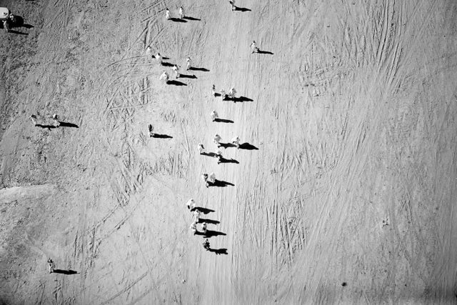 Helicopter view of women pilgrims walking in the desert on their way to Mount Arafat, where Mohammad became a prophet.