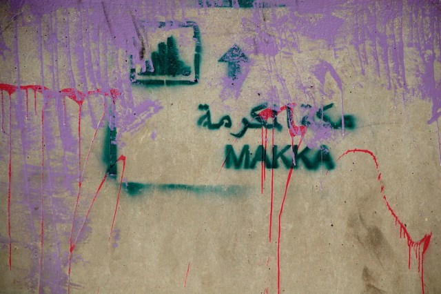 """Makka"" with a skyline: a commentary on the construction around the holy site of the Ka'ba in Mecca, stenciled in al-Balad in Jeddah by Sarah al-Abdali."