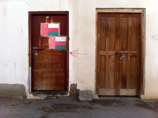 """Precious nation,"" written on a door in Muscat."