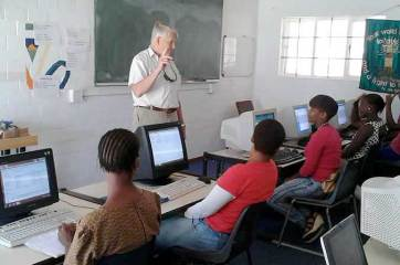 Masicorp founder, John Thompson, visits the Life Skills computing class