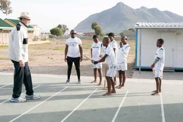Vince van der Bijl and Nceba Jonas coaching cricket