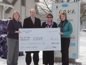 From left: Donna Yager, COVE Board President and Vice President-Marketing Officer, West Shore Bank;  and Raymond Biggs, President of West Shore Bank present Marie Waite, COVE Executive Director and Debra Goodwin