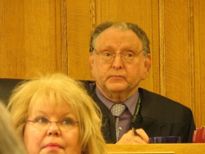 Judge Cooper listens.