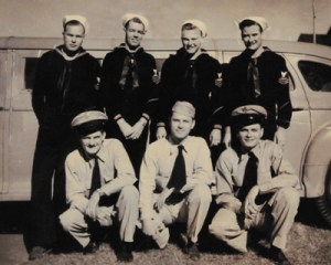 Leo, left, front, with some shipmates.