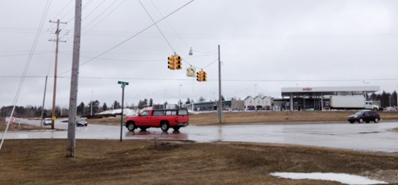 A driver turns left onto U.S. 10 at Brye Road, going through the red light earlier today.