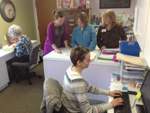 Employees and volunteers work to provide caring service.