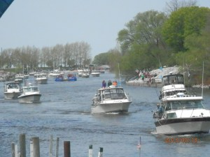 Boats come up the Manistee channel. Photo by Miranda Beebe.