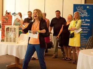 Annie Bayens of Pentwater responds to winning a chair.