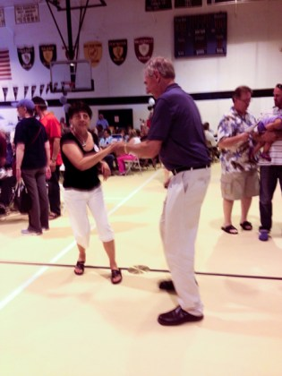 Jim (class of '61) and Dawn ('62) Jackoviak dance in the gym.
