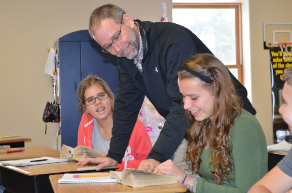 Rich Ambrose works with students at Covenant Christian School.
