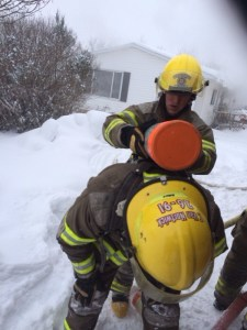 Firefighters replace air tanks.