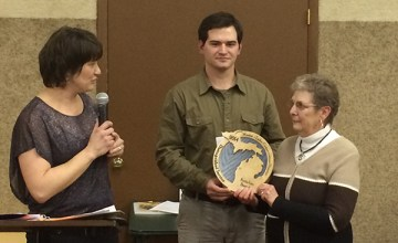 RuthAnn Berndt, right, receives a special award from Jordan DeVries and Sarah Slater, board chair.