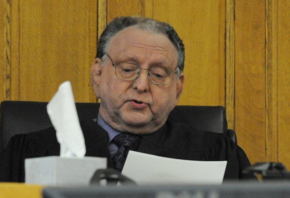 Judge Richard Cooper gives the jury instructions.