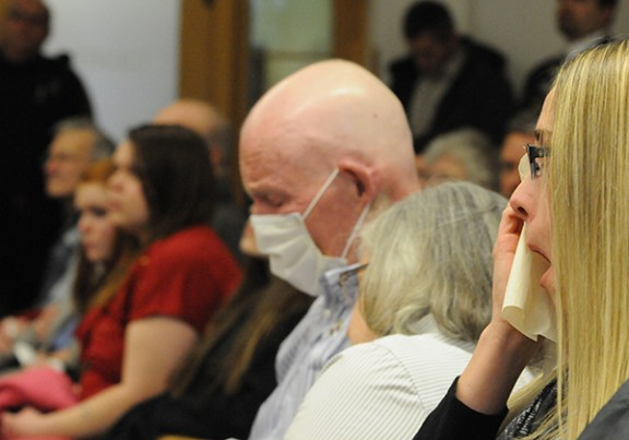 Paul Butterfield's fiance, Jennifer Sielski, right, and his father, Paul, react to the guilty verdict.