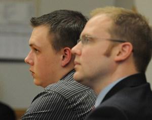 Eric Knysz and his attorney David Glancy listen to the verdict.