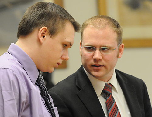 Eric Knysz speaks with his attorney, David Glancy.