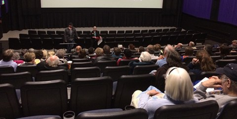 Cronk and Beth Mueller talk to the audience.