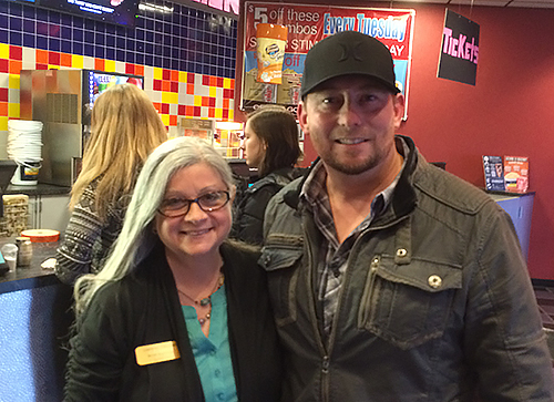 Director Harold Cronk with Beth Mueller, manager of the Carmike Harbor Cinema.