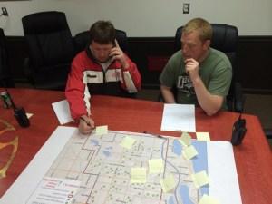 Chief Joe Cooper and Lt. Doug Tiffany look at a map of Riverton Twp.