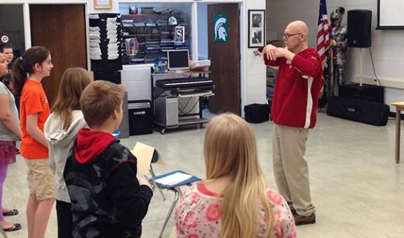 Bob Parker addresses his sixth grade music class.