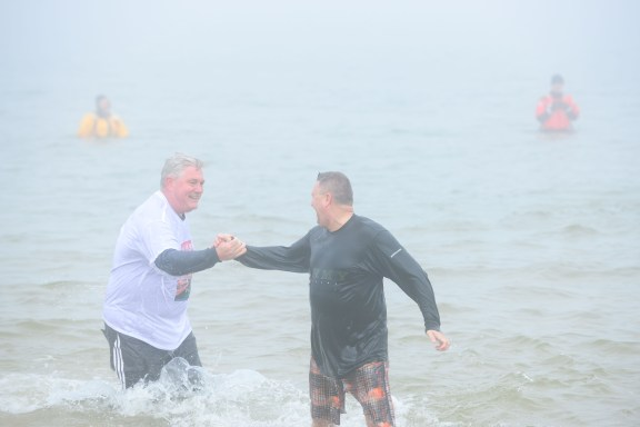 LPD Chief Mark Barnett and Sheriff Kim Cole bask in their post-jump victory.