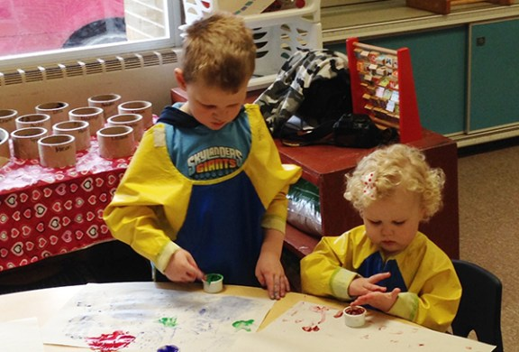 Simon, 5, and Lucy, 2, Duthler finger paint at the Ludington playgroup, held at Pere Marquette Early Childhood Center.