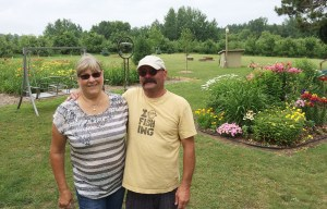 Barb and Dean Doty at their Riverton Twp. garden.
