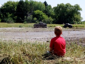Keegan Nelson watches the mud run.