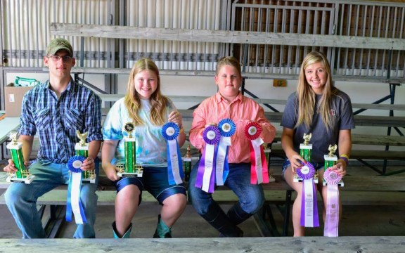 Poultry winners. From left: Alex Ooman, turkey grand champion reserve tom and grand champion cockerels; Alexandria Root, grand champion waterfowl; Travor Ooman, grand champion pullet, reserve market pullet; Jenni Herrema, grand champion hens turkey, reserve champion tom turkey.