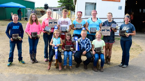 Beef Showmanship. Seated, from left: Autumn Weidus, 1st place; Kasey Gaudette, 2nd place; Logan Stakenas, 1st place open; Briana Crawford, 2nd place open. Back, from left: Ryan Crawford, 1st place; Peighton Scott, 2nd place beginner; Samantha Wilcose, 1st place intermediate; Kyle Lee, 2nd place intermediate; Faith Whitaker, 1st place jr.; Brooke Lee, 2nd place jr.; Devan Lindman, 1st place sr., reserve champion; Taylor Kroeze, 2nd place sr.
