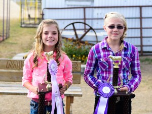 Dairy beef. From left: Abby Hays, reserve champion; McKenzie Nielsen, grand champion.