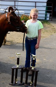 Brianna Crawford, overall champion female, overall cow-calf pair.