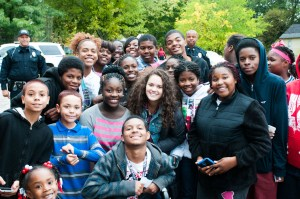 Teen actor Madison Pettis, center, poses with children from Muskegon Heights.
