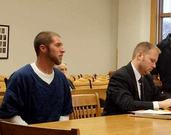 Essex, left, with his attorney, David Glancy.