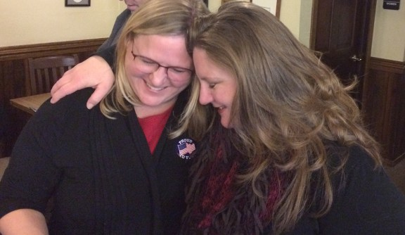 Sniegowski, left, is congratulated by her friend Colleen Unsal.