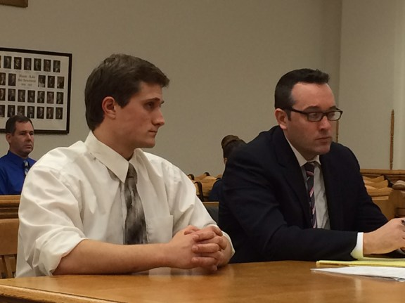 Cook, left, with his attorney Gary Springstead.