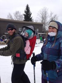 This little girl, riding down the slopes on Dad's back, was born to ski, her parents said.